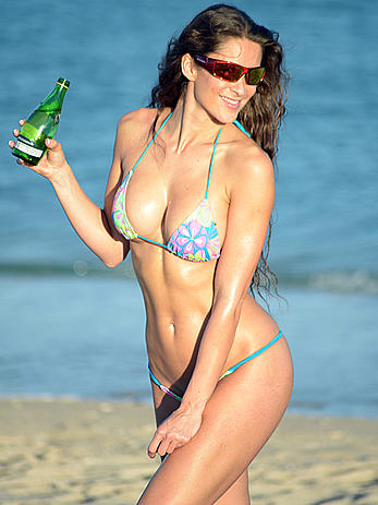 Anais Zanotti sunbathing topless on a beach