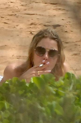 Ashley Benson caught topless at the beach in Hawaii