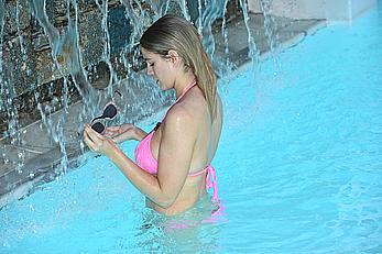 Ashley James in pink bikini at a pool in Mykonos