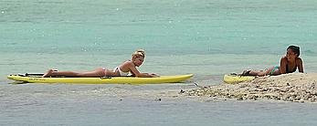 Ava Sambora paddle boarding on vacation in Bora Bora
