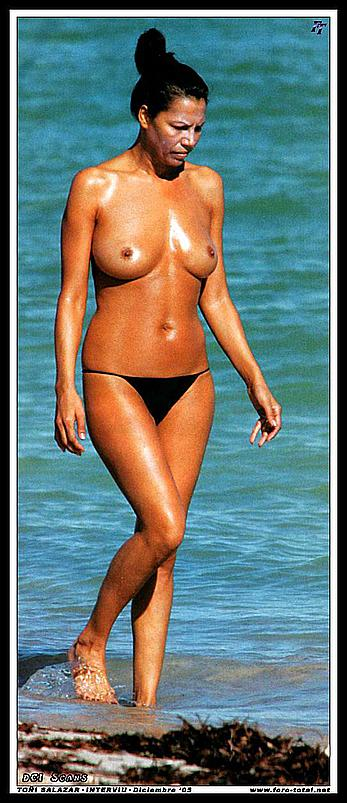 Azucar Moreno caught topless on a beach