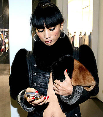 Bai Ling side of boob out & about