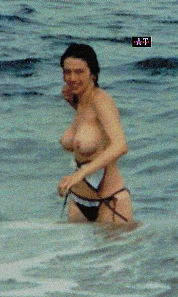Beatriz Rico caught topless on a beach