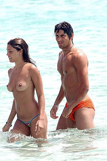 Belen Rodriguez caught topless on the beach in Spain