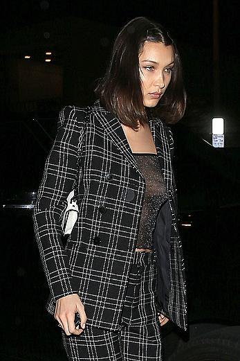 Bella Hadid braless under see through top