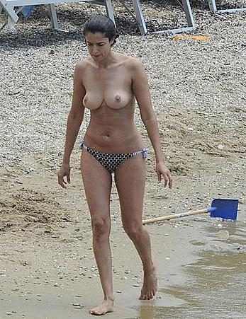 Blanca Romero caught topless on a beach