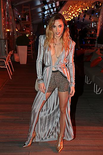 Capucine Anav legs and cleavage at Orange Cinema party in Cannes