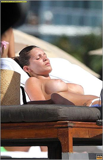 Carla Velli topless on a beach paparazzi photos