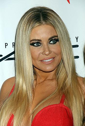 Carmen Electra cleavage in red dress at Grand Opening of Cherry Boom Boom at the Tropicana Las Vegas