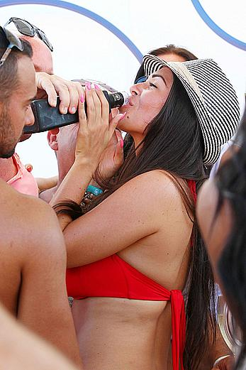 Casey Batchelor in red bikini poolside with friends in Ibiza