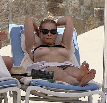 Chelsea Handler sunbathing topless at a beach in Mexico