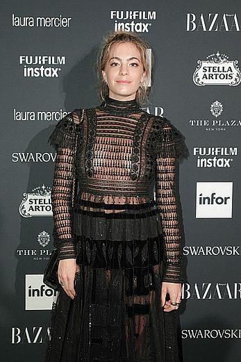 Chelsea Leyland in a see through black dress at Harper's Bazaar Icons party