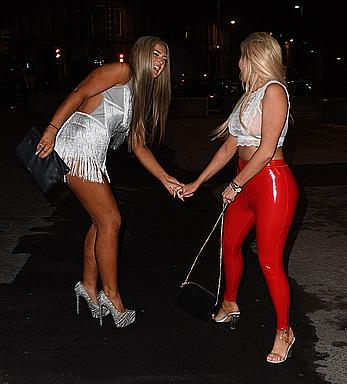Chloe Ferry in see through top and red pants