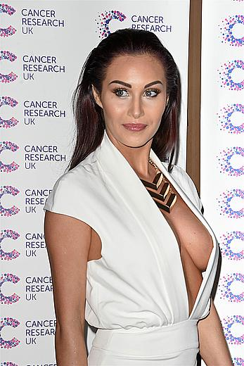 Chloe Goodman sexy cleavage in white dress at cancer fundraising event