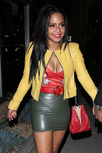 Christina Milian in tight short skirt shows legs and cleavage