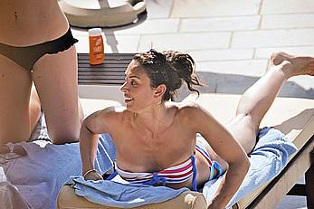 Busty Christine Bleakley tanning in bikini, shows nipple slip
