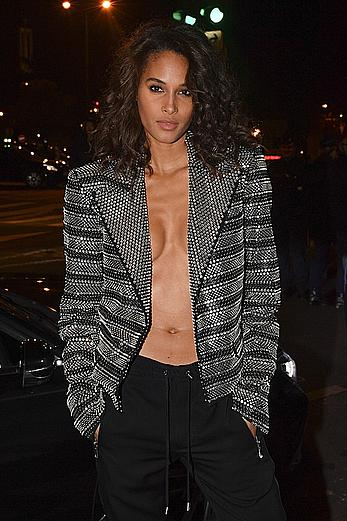 Cindy Bruna braless in metalic jacket at Balmain Homme show in Paris