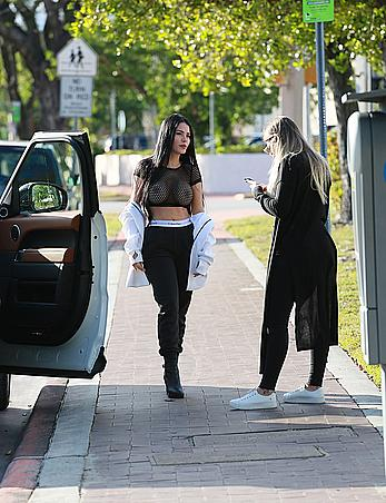 Claudia Alende in see through top taking a walk