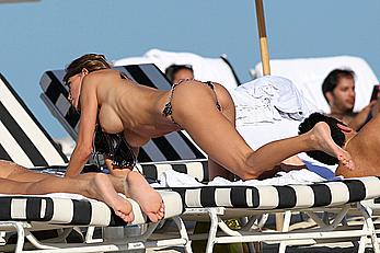 Claudia Galanti sunbathing topless at the beach with her friends