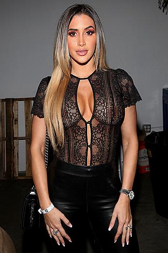 Claudia Sampedro posing in see through top