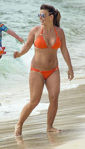Coleen Rooney in orange bikini on a beach in Barbados