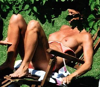 Cristina Parodi sunbathing topless on a beach