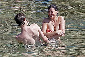 Daisy Lowe caught topless on the beach in Ibiza