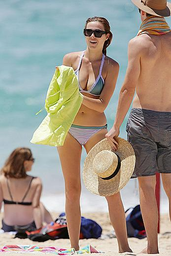 Demi Harman shows sexy cleavage on the beach in Sydney