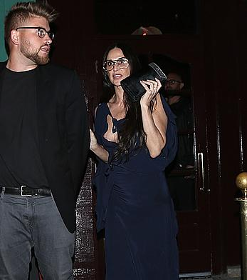 Demi Moore nipple slip in dark blue dress in West Hollywood