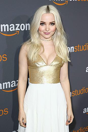 Blonde Dove Cameron shows cleavage at Amazon Studios Golden Globes party