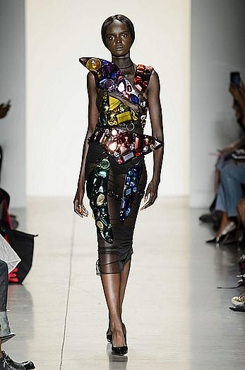 Duckie Thot see through dtressed at during Jeremy Scott Spring 2018 fashion show at New York Fashion Week