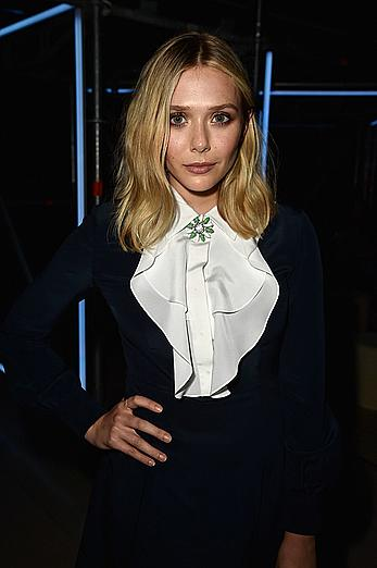 Elizabeth Olsen upskirt, shows her pants at Miu Miu Fragrance And Croisiere 2016 Collection Launch in Paris