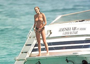 Elle Macpherson topless on a yacht