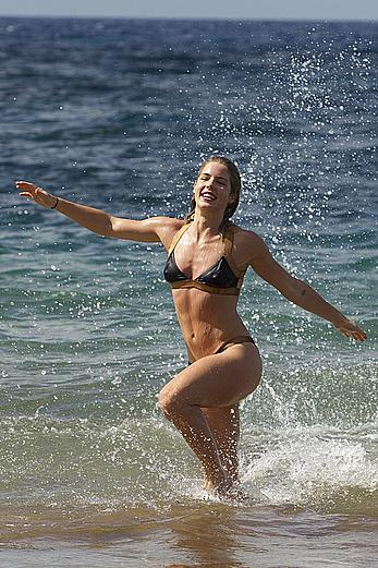 Emily Bett Rickards in bikini at the beach in Maui