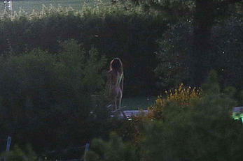 Emily Ratajkowski nude from behind on set of Welcome Home in Italy