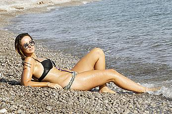 Fran Newman-Young in bikini on a beach during her stay in Ibiza