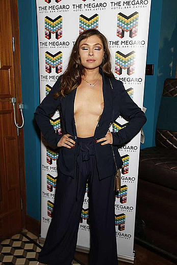 Fran Parman posing braless in jacket flashes her nipples