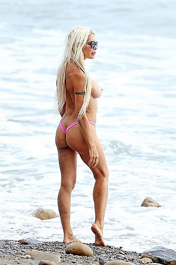Frenchy Morgan topless on a beach in Malibu
