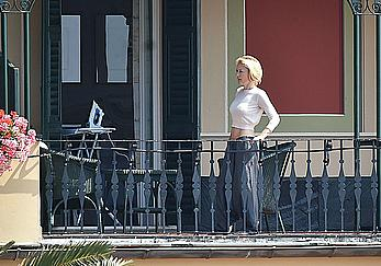 Gillian Anderson without bra under see through top showing nips at her hotel balcony