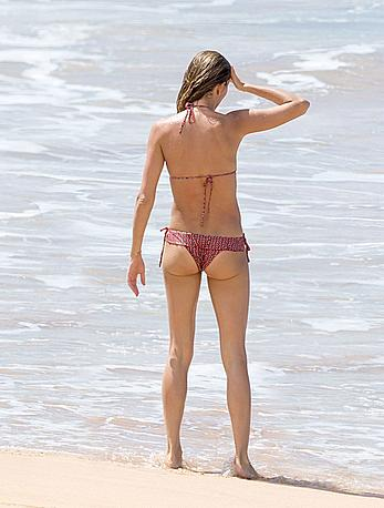Gisele Bundchen wearing a bikini on the beach in Brazil