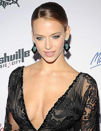 Hannah Ferguson shows cleavage in sexy dress