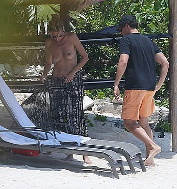 Heidi Klum caught topless on a beach in Mexico