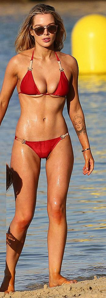 Helen Flanagan sexy in red bikini in a beach in Dubai