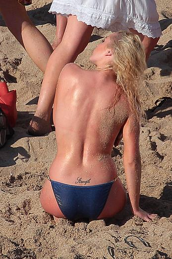 Helen Flanagan nude boob completely exposed at the beach in Ibiza
