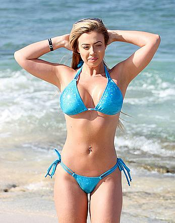 Holly Hagan in blue bikini on the beach in Ibizza