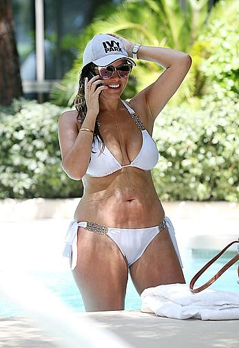Busty Imogen Thomas relaxing in white bikini in the hot tub at her Las Vegas pool