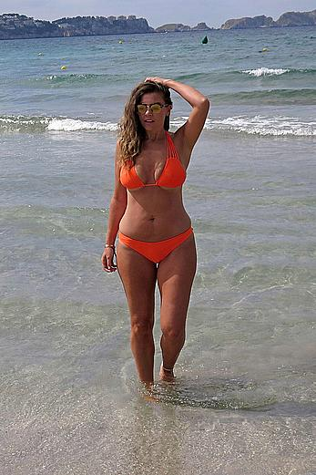 Imogen Thomas in orange bikini in Mallorca