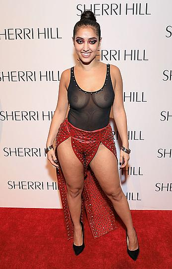 Inas X posing in see through black top at New York Fashion Week at Gotham Hall