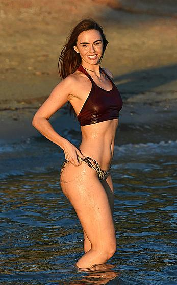 Jennifer Metcalfe pokies in wet bikini on a beach in Ibiza