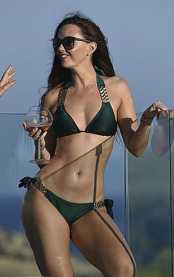 Jennifer Metcalfe in bikini by the pool in Ibiza